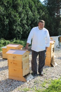 Executive Chef Joe Plucinski beside one of the hives in the Marriott Lincolnshire's apiary. Images courtesy of Julie Henning.