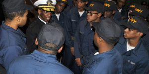 NAVAL STATION GREAT LAKES, Ill., -- Rear Adm. Norman R. Hayes, Director, National Security Operations Center, National Security Agency, talks with recruits at Recruit Training Command (RTC) Feb. 13 following a capping ceremony at Battle Stations 21. Battle Stations 21 is held entirely on USS Trayer (BST 21), an Arleigh Burke-Class destroyer simulator. Battle Stations 21 is the culmination of all training received at the Navy's only boot camp. It is a grueling 12-hour test, now held entirely in Trayer, of a recruit's skills in several shipboard evolutions, including fighting fires and stopping floods. It is also the final evolution that marks the recruit's final rite of passage into the Navy. Hayes was also the reviewing officer for graduation at RTC, the Navy's only boot camp. Official U.S. Navy photo by Scott A. Thornbloom, Naval Service Training Command Public Affairs Office. (RELEASED)