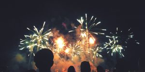 Crowd of Silhouetted People Watching a Colorful Fireworks Display for New Years or Fourth of July Celebration Event, Horizontal, Copy Space